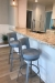 Amisco's Brock Swivel Bar Stools in Silver Metal and Blue Seat/Back Cushion in Kitchen Island with White Cabinets