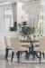 Darafeev's Dara Upholstered Flexback Dining Chair in Modern Dining Room with Table and Chandelier