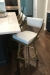 Amisco's Fame Modern Gold Swivel Counter Stools with Off-White Upholstery in Modern Kitchen