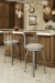 Amisco's Whisky Metal and Wood Swivel Bar Stools with Low Back in Traditional Wood Kitchen