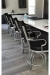 Lisa Furniture's #2545 Tilt Swivel Stools with Arms in Kitchen, Shown in Metallic Finish and Black Vinyl