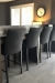Trica's Modern Upholstered Biscaro Counter Stools in Home Bar with Gray/Black Colors