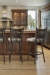 Trica's Creation Collection Armless Swivel Bar Stool with Elk Design on Backrest in Traditional Brown Kitchen