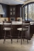 Trica's Louis Metal Swivel Bar Stools with Seat Cushion and Ladder Back Design in Traditional, Dark Brown Kitchen