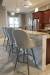 Amisco's Weston Comfortable Upholstered Swivel Bar Stool with Backs in Transitional Kitchen