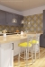 Holland's Catalina Swivel Bar Stool in Anodized Nickel and Yellow Seat Cushion in Modern Kitchen