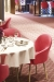 Amisco Weston Dining Chairs in Red Fabric in Conference Room