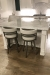 Amisco's Ronny Swivel Counter Stools in Silver and Gray - In Transitional Modern White Kitchen