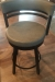Amisco's Ronny Brown Swivel Counter Stool with Curved Back, Round Seat and Metal Frame