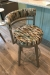 Amisco's Ronny Swivel Counter Stool with Curved Back Upholstered in Funky Pattern
