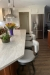 Amisco's Barry Swivel Counter Stools in Modern White Brown Kitchen